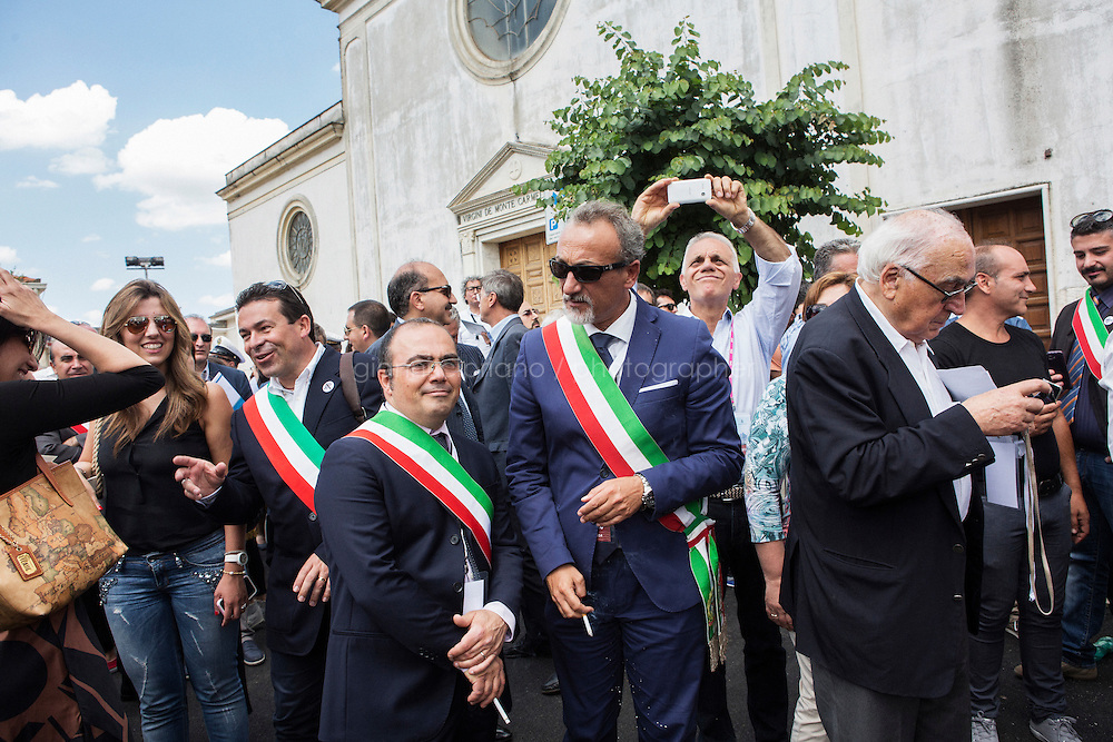 GRASSANO, ITALY - 24 JULY 2014: Mayors of the province of Matera (wearing Italian mayoral sashes) wait for Mayor of New York Bill de Blasio to come out of the city hall and go up on stage in Grassano, his ancestral home town in Italy, on July 24th 2014.<br /> <br /> Mayors of the province of Benevento (in the first three rows, wearing an Italian mayotal sashes) and local residents listen to the speeches of local officials introducing Mayor of New York Bill De Blasio before giving him a honorary citizenship of Sant'Agata de Goti, the ancestral home town where Mr De Blasio is originally from, in Italy on July 23rd 2014.<br /> <br /> <br /> New York City Mayor Bill de Blasio arrived in Italy with his family Sunday morning for an 8-day summer vacation that includes meetings with government officials and sightseeing in his ancestral homeland.