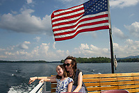 Mother and child sitting on the top deck of the mail boat Sophie C during her route around the islands of Lake Winnipesaukee.  Karen Bobotas for the Laconia Daily Sun