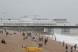 © Licensed to London News Pictures. 04/07/2014. Brighton, UK. Rain and clouds has stopped most people from visiting the South Coast while rough seas dettered people from swimming. Photo credit : Hugo Michiels/LNP
