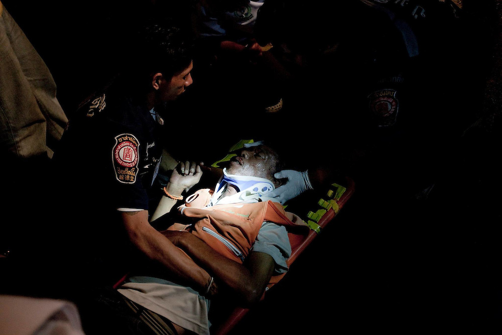 12:29 AM A severly injured motorcycle driver is rushed to hospital. On the night shift: Bangkok's body collectors. Paid per casualty, private ambulance crews race through the Thai capital on a nightly hunt for the injured and deceased.<br />