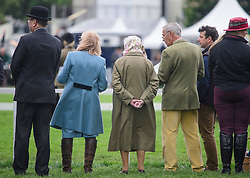 © Licensed to London News Pictures. 12/05/2017. Windsor, UK.  HRH QUEEN ELIZABETH II (centre) seen watching over a competition on day three of the Royal Windsor Horse show. The five day equestrian event takes place in the grounds of Windsor Castle. Photo credit: Ben Cawthra/LNP