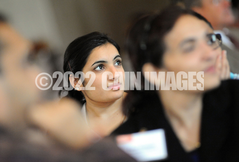 WARMISNER, PA -  OCTOBER 10: Pooja Tilvawala, 17, of Bensalem, Pennsylvania listens to a speaker at the 21st Annual YWCA Breakfast with Friends October 10, 2013 at Spring Mill Manor in Warminster, Pennsylvania.  (Photo by William Thomas Cain/Cain Images)