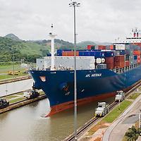 Cargo ship entering the Panama Canal at Miraflores Locks, Panama City, Central America