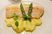 Bad St. Leonhard, Carinthia, Austria. Trippolts Zum Bären gourmet restaurant.<br /> Kärntner Berghuchen, Natur gebraten, Olivenöl-Spargel und Nussbutter-Püree.