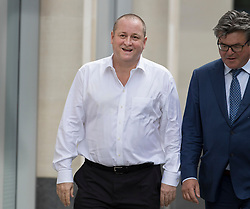 © Licensed to London News Pictures. 10/07/2017. London, UK. Newcastle United FC owner Mike Ashley (L) arrives at the High Court. Mr Ashley is in dispute with financial expert Jeff Blue over payments promised in relation to the share price of Sports Direct. Photo credit: Peter Macdiarmid/LNP
