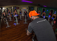 "Kale Poland leads the charge during the first hour of the 12 hour ""Bike-a-Thon"" at Body Design by Joy to raise money for NH Easter Seals Drug Prevention and Substance Abuse Programs.  (Karen Bobotas/for the Laconia Daily Sun)"