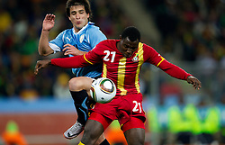 Nicolas Lodeiro of Uruguay vs Kwadwo Asamoah of Ghana during to the 2010 FIFA World Cup South Africa Quarter Finals football match between Uruguay and Ghana on July 02, 2010 at Soccer City Stadium in Sowetto, suburb of Johannesburg. (Photo by Vid Ponikvar / Sportida)