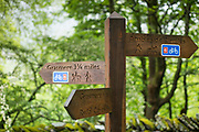 Signpost for public footpath, bridleway and cycleway towards Grasmere and Ambleside in the Lake District, Cumbria, England