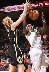 Virginia center Aisha Mohammed (33) grabs a rebound from Colorado guard Alyssa Fressle (1).  The #16 ranked Virginia Cavaliers women's basketball team defeated the Colorado Buffaloes 77-43 at the John Paul Jones Arena on the Grounds of the University of Virginia in Charlottesville, VA on November 24, 2008.