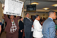 MAY 9, 2011 - MINEOLA, NY: Nassau County Legislative Redistricting Public Hearing, with woman carrying sign WILL THERE STILL BE 5 TOWNS OR TWO AND A HALF? referring to one of the proposed district changes. At Nassau County Executive and Legislative Building at 1550 Franklin Avenue, Mineola, New York, USA.