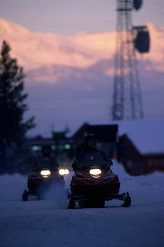 Yellowstone National Park, Snowmobiling in park at West entrance.