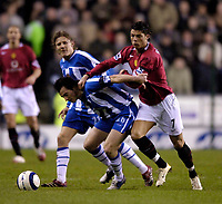 Photo: Jed Wee.<br /> Wigan Athletic v Manchester United. The Barclays Premiership. 06/03/2006.<br /> <br /> Manchester United's Cristiano Ronaldo (R) finds Wigan's Leighton Baines hard to get past.