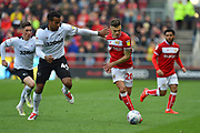 Jamie Paterson (20) of Bristol City battles for possession with Tom Huddlestone (44) of Derby County during the EFL Sky Bet Championship match between Bristol City and Derby County at Ashton Gate, Bristol, England on 27 April 2019.