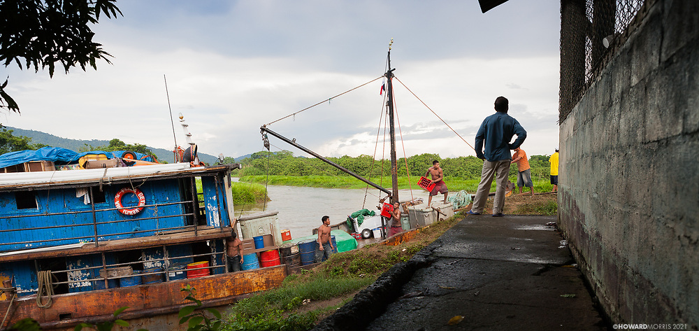 The monthly supply ship unloading goods under the watchful eye of it's captain, Boca de Sabalo (Sambu), Darien Province, Panama.
