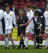 28/02/2004  -  Nationwide Div 1 Watford v Wimbledon.Wimbledon players' gather round referee Ray Olivier after he'd awarded a penalty to Watford..lefto right Rob Gier [22] Ray Olivier, Dean Lewington, keeper Steve Banks and Warren Barton.