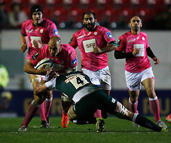 Sergio Parisse of Stade Francais is tackled by Dom Barrow of Leicester Tigers - Mandatory byline: Jack Phillips / JMP - 07966386802 - 13/11/15 - RUGBY - Welford Road, Leicester, Leicestershire - Leicester Tigers v Stade Francais - European Rugby Champions Cup Pool 4