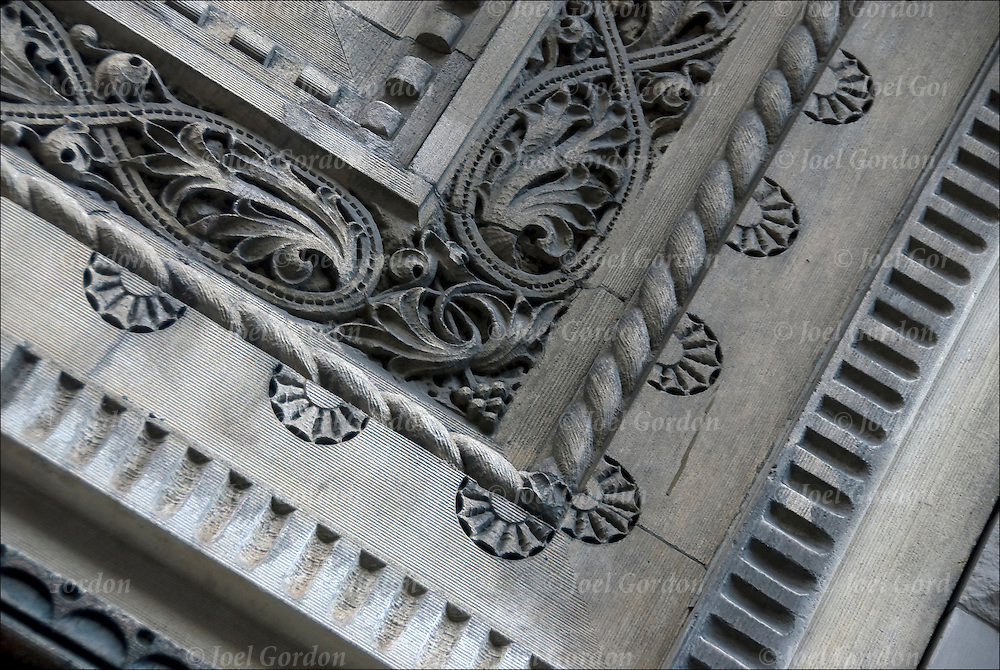 Close up of repeating and repetition of decorative patterns and design on nineteen century exterior architectural details of  on  side of of building in flat iron district.