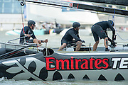 Emirates Team New Zealand competing in day two of the Extreme Sailing Series regatta being sailed in Singapore. 21/2/2014