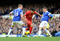 Liverpool's Luis Suarez passes Everton's James McCarthy and Everton's Ross Barkley - Photo mandatory by-line: Dougie Allward/JMP - Tel: Mobile: 07966 386802 23/11/2013 - SPORT - Football - Liverpool - Merseyside derby - Goodison Park - Everton v Liverpool - Barclays Premier League