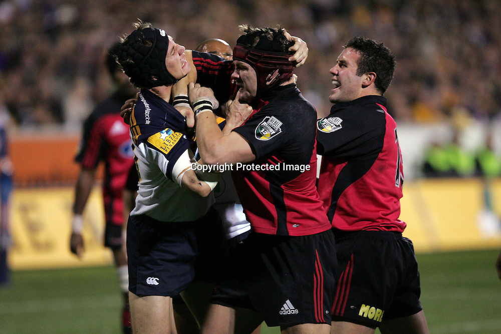 22 May, 2004. Super 12 Final, Canberra Stadium, Canberra ACT, Australia.<br /> Stephen Larkham and Ritchie McCaw.<br /> The Brumbies defeated the Crusaders  48-37<br /> Please credit: Andrew Cornaga/Photosport