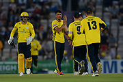 Mujeeb Ur Rahman of Hampshire is congratulated on the wicket of Dawid Malan during the Vitality T20 Blast South Group match between Hampshire County Cricket Club and Middlesex County Cricket Club at the Ageas Bowl, Southampton, United Kingdom on 20 July 2018. Picture by Dave Vokes.