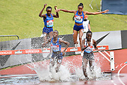 Norah Jeruto (KEN) front left, leads Hyvin Kiyeng (KEN) right, in the women's steeplechase during the Birmingham Grand Prix, Sunday, Aug 18, 2019, in Birmingham, United Kingdom. (Steve Flynn/Image of Sport via AP)