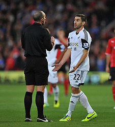 Swansea City's Angel Rangel complains to ref after Cardiff City's Craig Bellamy tackle- Photo mandatory by-line: Alex James/JMP - Tel: Mobile: 07966 386802 03/11/2013 - SPORT - FOOTBALL - The Cardiff City Stadium - Cardiff - Cardiff City v Swansea City - Barclays Premier League