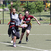Players in action during the 7th Annual AIG NYC Rugby Cup at Randall's Island, Manhattan, New York. USA. 7th June 2014. Photo Tim Clayton