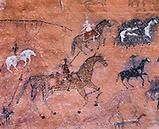 0100-1023 ~ Copyright: George H.H. Huey ~ Historic Navajo Indian pictograph panel showing invading Spanish horseman.  From  late 1700's/early 1800's.  Canyon del Muerto, Canyon de Chelly National Monument, Arzona.