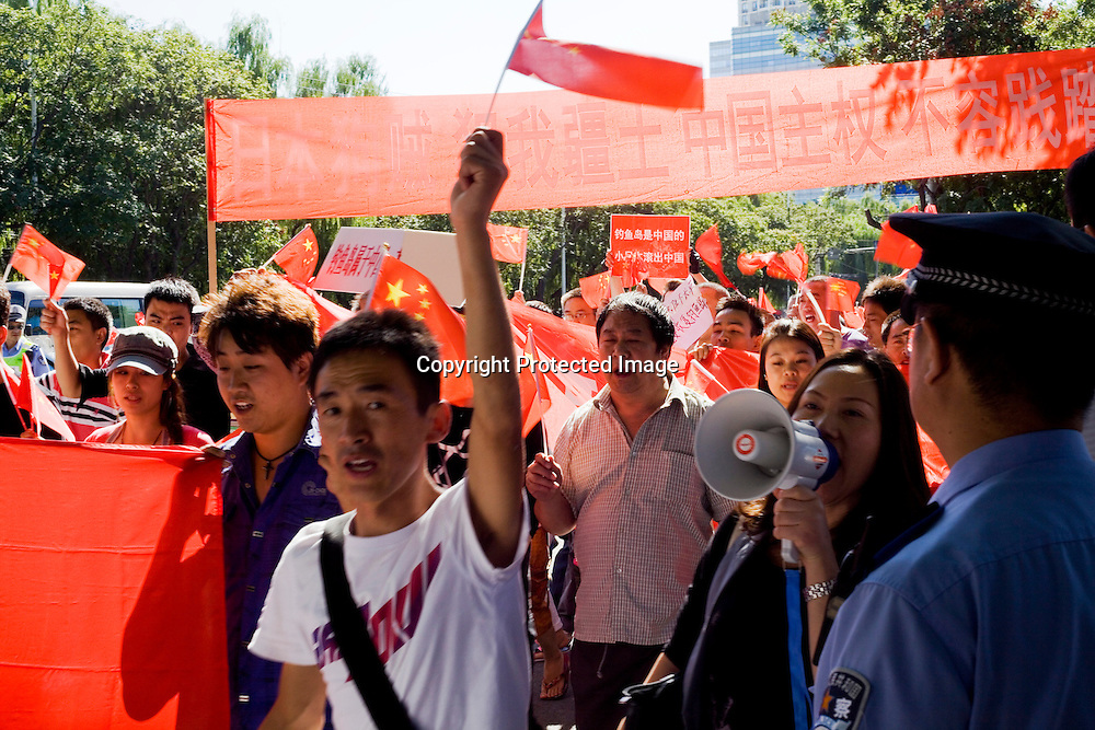 BEIJING, SEPTEMBER -14 : Chinese protesters shout anti-Japanese slogans  outside the Japanese Embassy in Beijing . Chinese citizens protest  against Japan's 'nationalizing' of the Diaoyu islands, known as the Senkaku Islands in Japan, outside the Japanese embassy in Beijing. China has dispatched two patrol ships to 'assert its sovereignty' over islands at the centre of a row with Japan.
