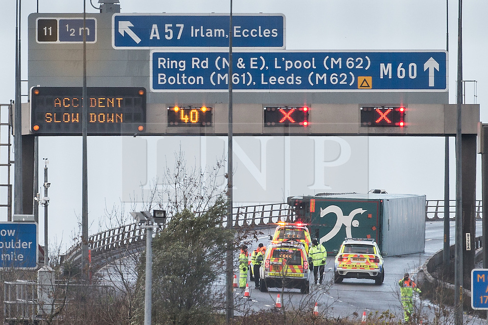 © Licensed to London News Pictures . 05/12/2013 . Manchester , UK . An overturned lorry on the Barton Bridge on the M60 orbital road around Manchester as very high winds causes damage across the UK . Photo credit : Joel Goodman/LNP