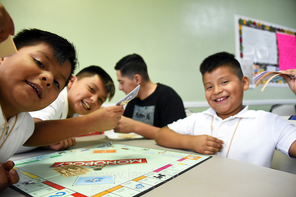 It's game time at LIFE after-school program in East Salinas. From left, Alex Reyes, Rafael Hernandez, Juan Villicaña and Carlos Mejia enjoy the action.