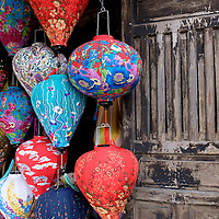 Colorful fabric lanterns on display in Hoi An, Vietnam.