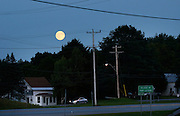 The Supermoon rises over Route 12 in Port Leyden, NY, Sunday, August 10, 2014. Port Leyden was the hometown of  Kevin Ward, 20, who was killed by famed racecar driver, Tony Stewart, during a speedway accident in Canandaigua, NY. <br /> (Heather Ainsworth for The New York Times)