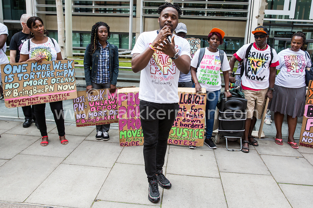London, UK. 10 July, 2019. Hamza, a Movement for Justice campaigner, addresses a  protest outside the Home Office against the government department's decision to try to block the return to the UK of PN, a Ugandan lesbian removed from the UK using the now unlawful fast track procedure in 2013 but who the High Court ordered on 24th June must be returned to the UK by the Home Office after the handling of her case was ruled to be 'procedurally unfair'.