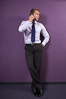 Businessman using mobile phone at office