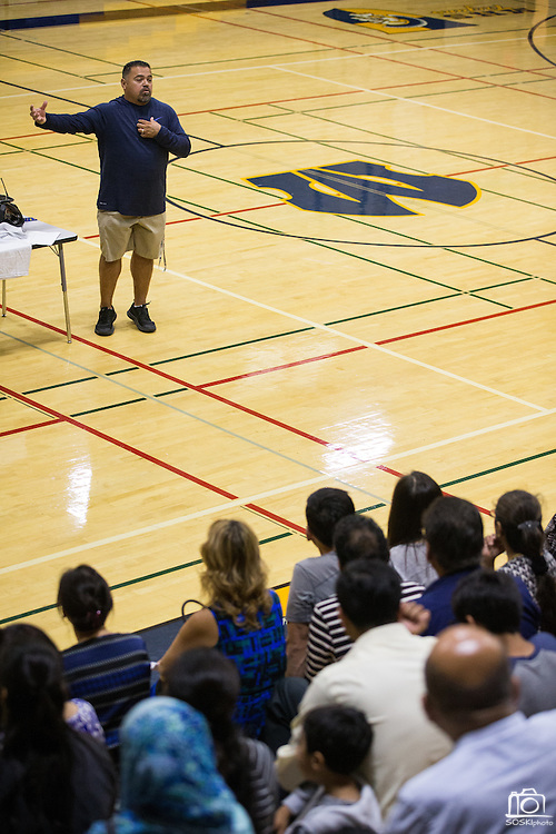 P.E. teacher Jesus Zamudio talks with parents during Back To School Night at Milpitas High School in Milpitas, California, on August 30, 2016. (Stan Olszewski/SOSKIphoto)