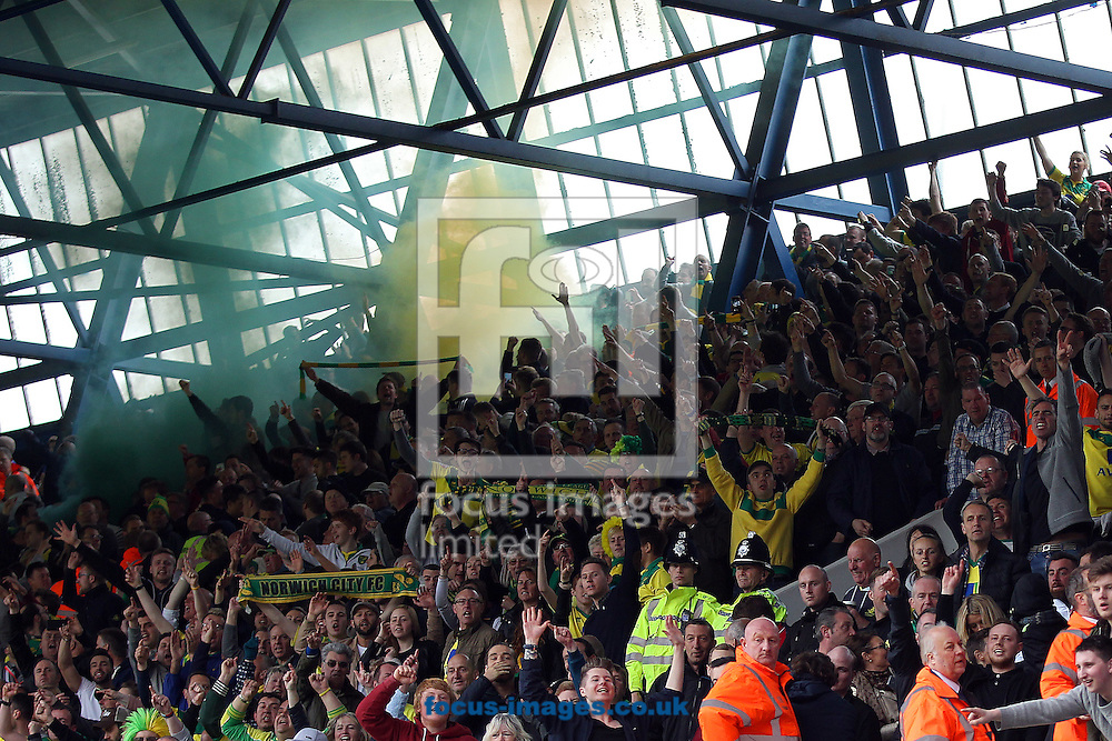 The traveling Norwich fans celebrate their side's 1st goal and let off a flare during the Sky Bet Championship play off semi final first leg at Portman Road, Ipswich<br /> Picture by Paul Chesterton/Focus Images Ltd +44 7904 640267<br /> 09/05/2015