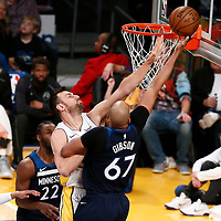 25 December 2017: Minnesota Timberwolves forward Taj Gibson (67) goes for the layup past Los Angeles Lakers center Andrew Bogut (66) during the Minnesota Timberwolves 121-104 victory over the LA Lakers, at the Staples Center, Los Angeles, California, USA.