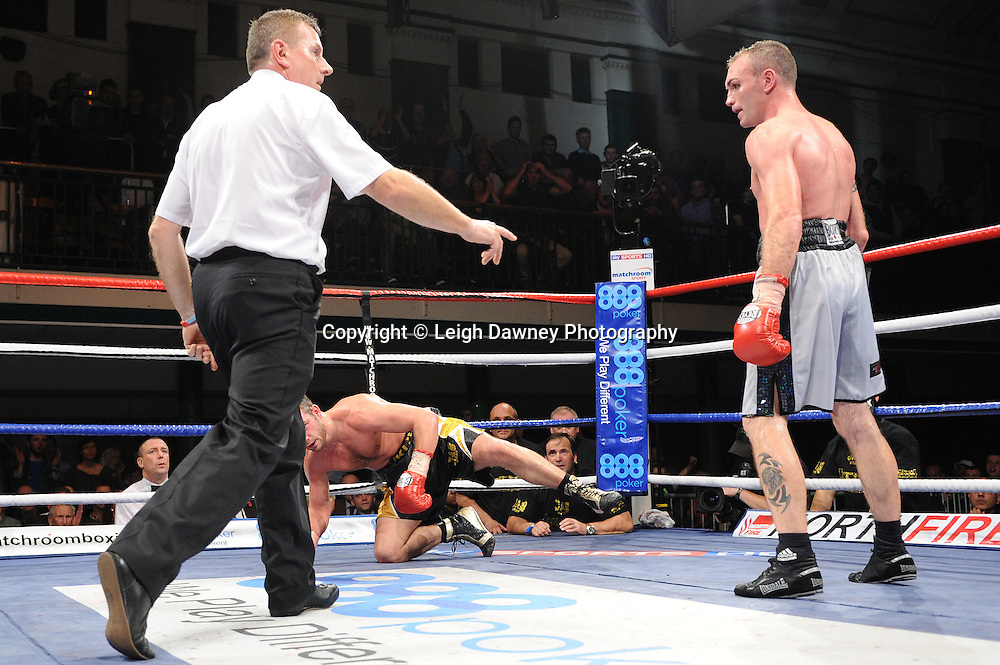 Colin Lynes knocks down  Lee Purdy for the British Welterweight Title at York Hall 09.11.11. Matchroom Sport. Photo credit: © Leigh Dawney 2011.