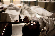 "Dead body of a drug addict in the morgue of the Edhi Foundation. Every day arrive at the Clinic bodies of addicts died from drug-related issues. Karachi, Pakistan, on sunday, December 07 2008.....""Pakistan is one of the countries hardest hits by the narcotics abuse into the world, during the last years it is facing a dramatic crisis as it regards the heroin consumption. The Unodc (United Nations Office on Drugs and Crime) has reported a conspicuous decline in heroin production in Southeast Asia, while damage to a big expansion in Southwest Asia. Pakistan falls under the Golden Crescent, which is one of the two major illicit opium producing centres in Asia, situated in the mountain area at the borderline between Iran, Afghanistan and Pakistan itself. .During the last 20 years drug trafficking is flourishing in the Country. It is the key transit point for Afghan drugs, including heroin, opium, morphine, and hashish, bound for Western countries, the Arab states of the Persian Gulf and Africa..Hashish and heroin seem to be the preferred drugs prevalence among males in the age bracket of 15-45 years, women comprise only 3%. More then 5% of whole country's population (constituted by around 170 milion individuals),  are regular heroin users, this abuse is conspicuous as more of an urban phenomenon. The substance is usually smoked or the smoke is inhaled, while small number of injection cases have begun to emerge in some few areas..Statistics say, drug addicts have six years of education. Heroin has been identified as the drug predominantly responsible for creating unrest in the society."""