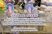 05 NOVEMBER 2004 - MEXICO CITY, MEXICO:   A donation box for Santa Muerte (St. Death) in a jewelry store in Mexico City. St. Death is venerated throughout Mexico and Mexican communities in the United States. The veneration of St. Death started in Mexico's prisons about 10 years and has since spread through working class neighborhoods in many Mexican cities. The worship St. Death was recognized as an official religion by the Mexican government in 2003. The Catholic Church in Mexico is opposed to the worship of St. Death and has held rallies and prayer vigils against the Saint. The small church in Tepito is frequently swamped with visitors and the religion has spread quickly through the tough, drug and crime plagued neighborhood, widely considered the most lawless in Mexico City. There are about 40 shrines to St. Death throughout Mexico City.    PHOTO BY JACK KURTZ
