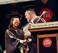 Irene Bedard, left, the voice of Walt Disney's Pocahontas, is congratulated by Dean Stephen Jay, right, after receiving the alumni award from her alma mater, The University of the Arts, Thursday, May 20, 1999, in Philadelphia. Bedard earned her BFA from the University of the Arts in 1991. (Photo by William Thomas Cain)