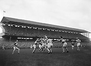 A group of players all surround the ball hoping to gain possession during the All Ireland Senior Gaelic Football final Dublin vs Derry in Croke Park on 28th September 1958. Dublin 2-12 Derry 1-9.
