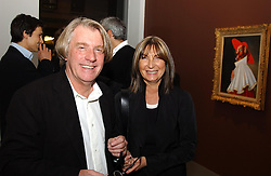 Art collector FRANK COHEN and MRS FRANK COHEN at an exhibition of paintings by artist George Condo entitled 'Religious Paintings' held at the Spruth Magers Lee Gallery, 12 Berkeley Street, London W1 on 12th October 2004.<br />