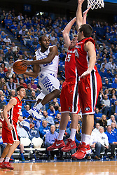 Kentucky guard Dominique Hawkins, left, drives around defenders in the second half.<br /> <br /> The University of Kentucky hosted the University of Georgia, Tuesday, Feb. 09, 2016 at Rupp Arena in Lexington .