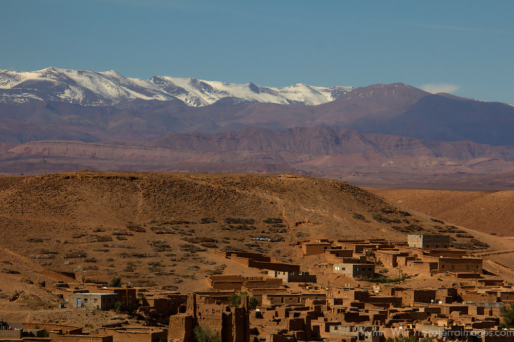 Africa, Morocco, Skoura. Moroccan desert village and snow-capped Atlas mountain range.