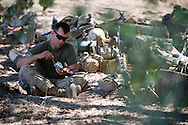 A Marine eats an MRE while relaxing before the days' live-fire exercises for the 2nd Battalion, 5th Marine Regiment at Camp Pendleton.