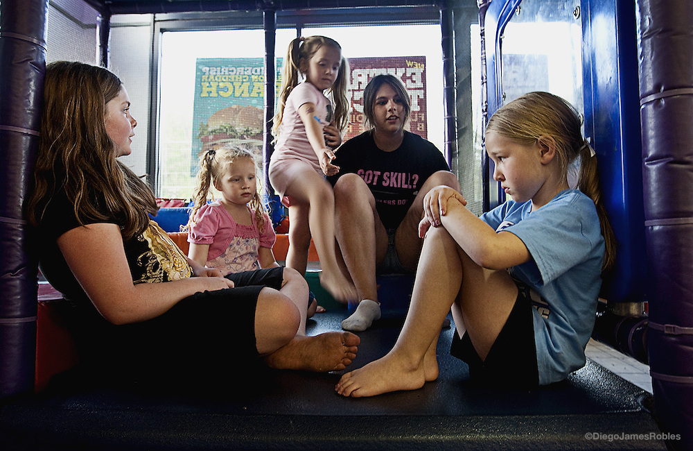 While their parents argue over the pageant logistics and details, from left, Racheal LeAnn Frost, Tomi Sue, Alexis Thompson and Stormy Daniels try, unsuccessfully, to console Heidi Jo, on Monday afternoon, April 27. Heidi Jo was accidentally stepped-on while the girls jumped in the Nelsonville Burger King play-pen.