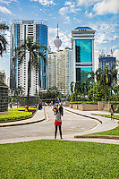 Lovely Lady Photographing Petronas, KLCC